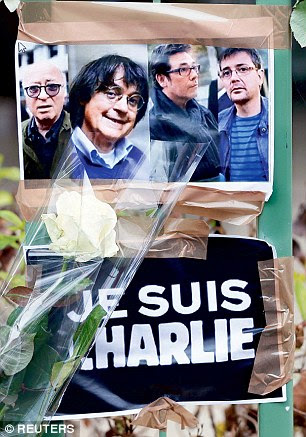 Flowers: Tributes to Charlie Hebdo staff Georges Wolinski, Cabu, Tignous and Charb, all killed