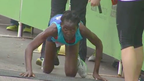 Austin-Marathon-Hyvon-Ngetich-Crawling-to-Finish