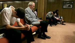 ** ADVANCE FOR SUNDAY, JUNE 4 **Pastor Fred Phelps, center, sits in prayer at his Westboro Baptist Church in Topeka, Kan. March 19, 2006. Phelps and his tight-knit congregation travel the country preaching damnation to a