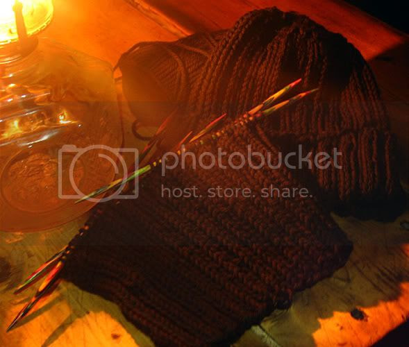 I knit hats in the evenings beside the wood stove, by the light of an oil lamp.