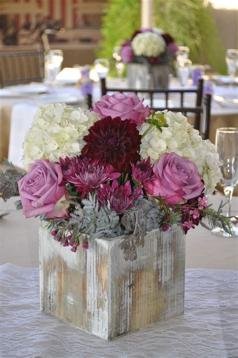 Fall and rustic style centerpiece using lavender and plum