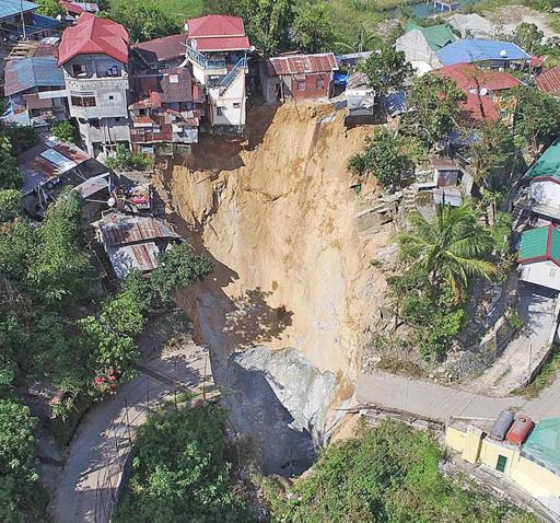 sinkhole benguet, sinkhole benguet october 2015 video, sinkhole benguet october 2015 picture, sinkhole benguet october 2015, sinkhole benguet philippines, A giant sinkhole swallowed 5 houses in Benguet, Philippines after the passage of Typhoon Lando. Photo video