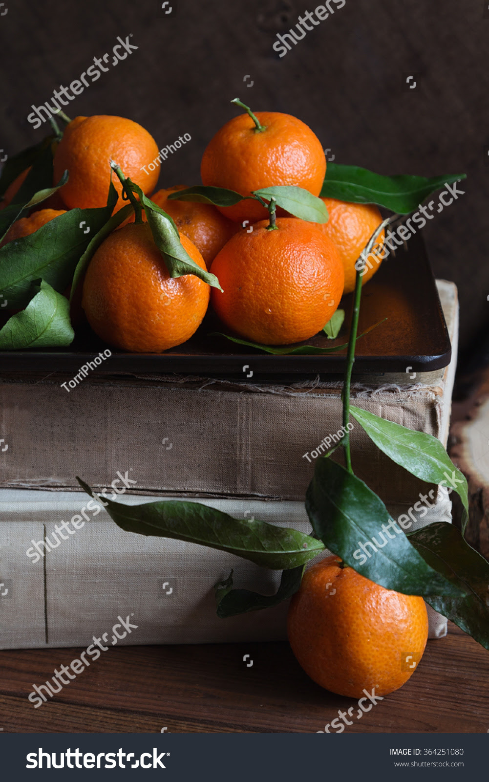 http://www.shutterstock.com/pic-364251080/stock-photo-mandarin-on-dark-wooden-background-vintage-style-shallow-focus.html