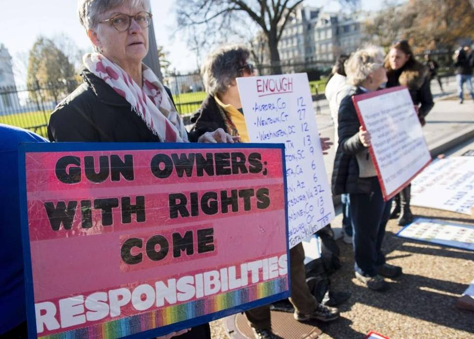 "Protesters with the group ""We the People for Sensible Gun Laws"" rally for gun safety legislation in Washington."