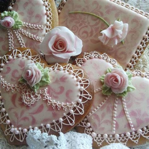 Royal icing cookie lace and roses etc.   cake by Teri
