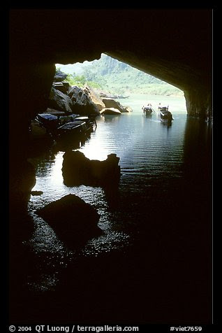 Interior and entrance of Phong Nha Cave with Rocks and boats. Vietnam (color)