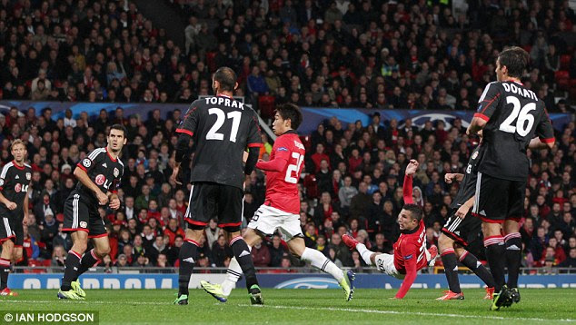 What a finish: Robin van Persie (left) leaps to hook in a superb volley to restore United's lead