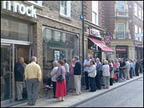 Customers queue up in the UK