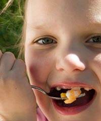A child eating eggs