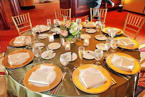 Opulent wedding reception table decor  gold charger plates