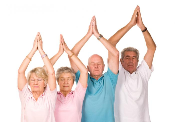 older people practicing yoga