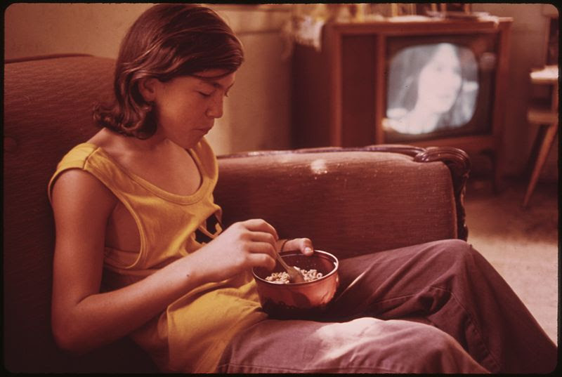 File:BILLY WATKINS EATS A BOWL OF CEREAL IN THE LIVING ROOM OF HIS HOUSE IN MULKY SQUARE. BILLY IS ONE OF 9 CHILDREN OF A... - NARA - 553529.jpg