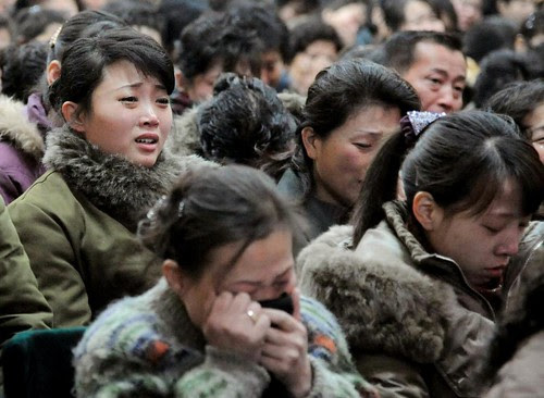 North Koreans mourn the loss of their leader Kim Jong Il on December 19, 2011. The country was shocked at the death of its leader on December 17. by Pan-African News Wire File Photos