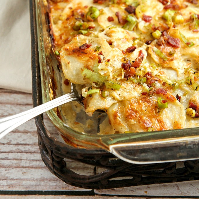 These Cheesy Potatoes with bacon and leeks are packed with creamy goodness, and make a great side dish for any holiday or special occasion dinner! This comfort food casserole is a tried and true family favorite! Family and friends will be begging you for the recipe!