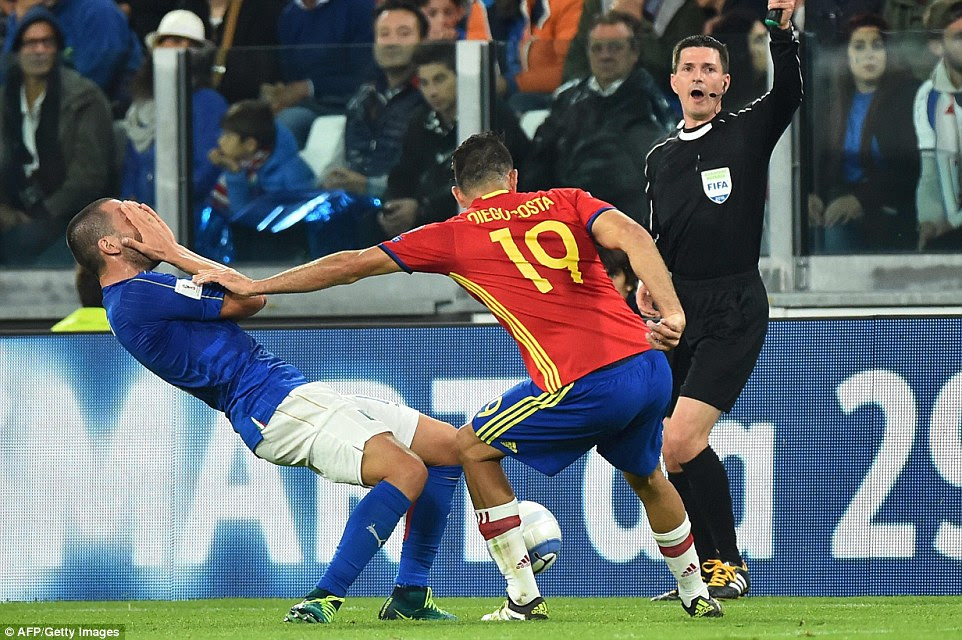 Italy defenderLeonardo Bonucci, who was linked with Manchester City, reacts after being palmed off by Costa