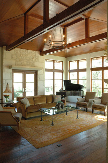 living room, grand piano, vaulted ceiling, wood planked ...