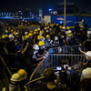 Pro-democracy protesters set up a new road block close to the chief executive office in Hong Kong late Sunday.
