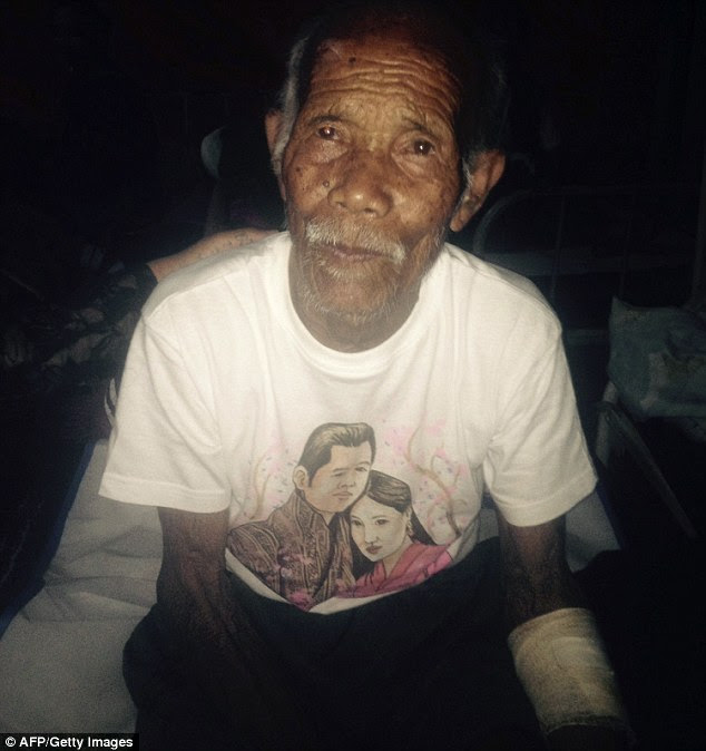 Miraculous:Funchu Tamang, 101, sits on a bed in a hospital in Nuwakot district  around 80 kilometres (50 miles) northwest of Kathmandu where he was taken after being rescued from his collapsed home a day earlier