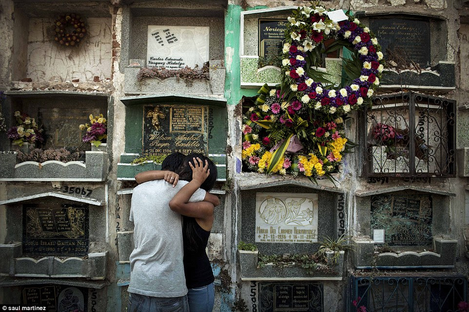 Mourning: School friends of a girl shot dead by a gang member break down during her funeral, held in Guatemala City on April 4 2014