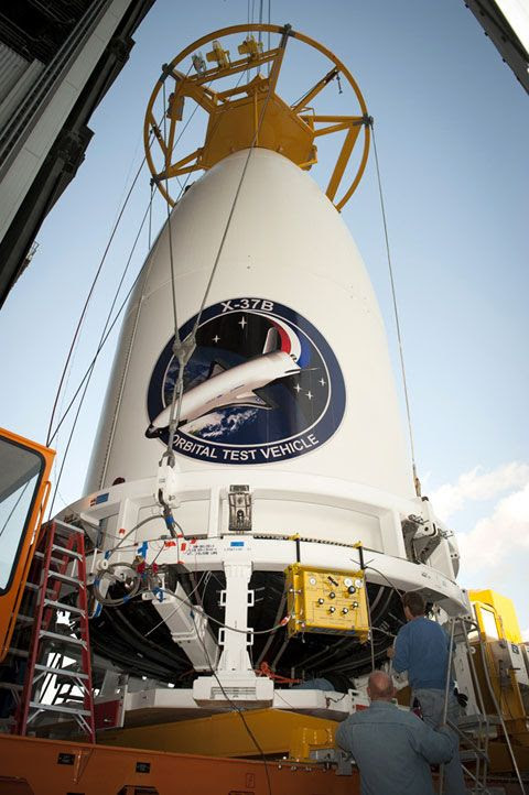 At Cape Canaveral Air Force Station's Space Launch Complex 41, the payload fairing carrying OTV-3 is about to be mated with the Atlas V rocket inside the Vertical Integration Facility.