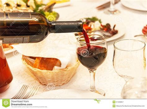 Red Wine Pouring Into A Wine Glass, That Standing On The