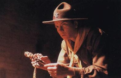 Young Life Scout Indiana Jones (River Phoenix) holding the Cross of Coronado in Indiana Jones and the Last Crusade