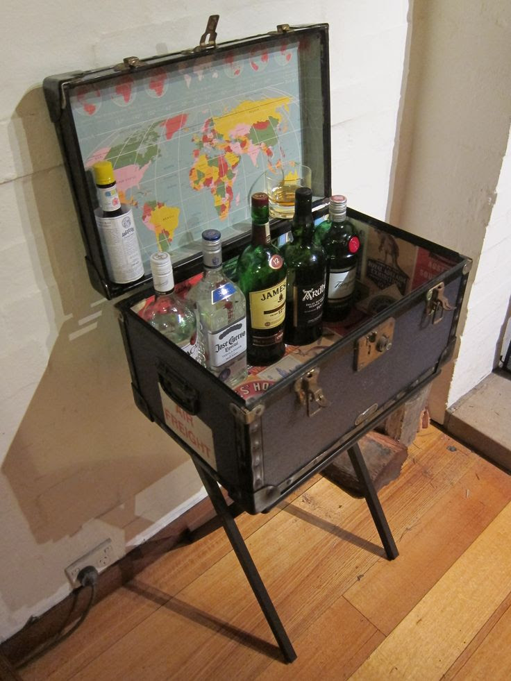 DIY BAR: This is a steamer trunk I found on Gumtree (Aussie Craigslist!)--I decided to re-line it with funky travel-themed paper, put it on legs and use it as a bar!  See how I did it here: https://lifeimitatingartblog.squarespace.com/blog/2013/8/5/p9d6scvxurysztlblpx4o1h6h1xzbk