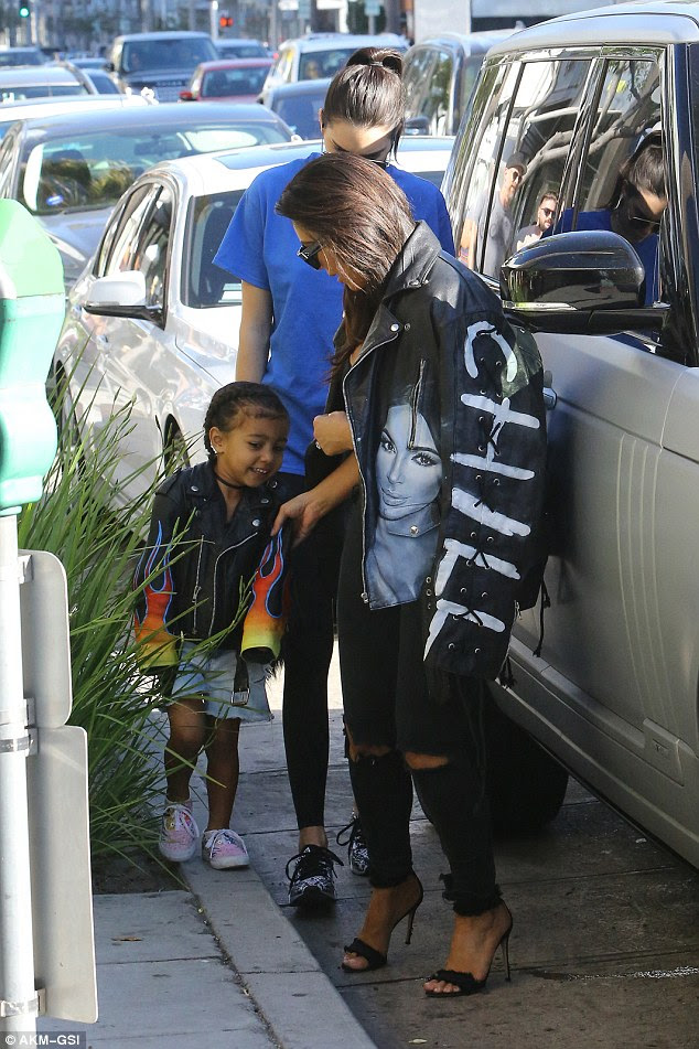 Adoring: North pulled a series of funny faces as she maneuvered the pavement