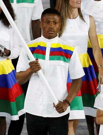 Flagbearer Jonas Junius of Namibia leads his contingent during the opening ceremony. Brazilian police have arrested Junius on suspicion of attempting to secually assault a room maid at the Olympic Village. REUTERS/Stoyan Nenov/Files