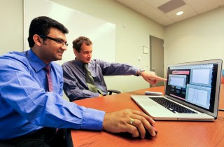 ORNL researchers Phani Teja Kuruganti (left) and James Nutaro developed the Radio Channel Simulator software.