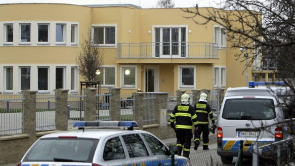 Firefighters search an area after an explosion in Prague January 1, 2014. The Palestinian ambassador to Czech Republic Jamal al-Jamal has died after an explosion at his residence in Prague on Wednesday, according to Czech police.