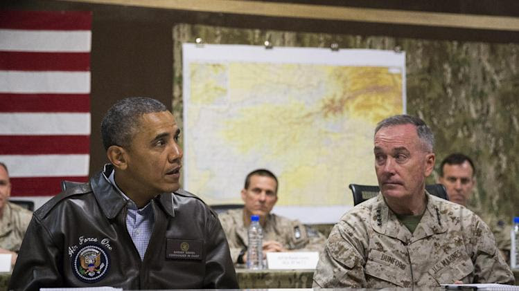 President Barack Obama, left, speaks during a briefing by Marine General Joseph Dunford, commander of the US-led International Security Assistance Force (ISAF), after arriving at Bagram Air Field for an unannounced visit, on Sunday, May 25, 2014, north of Kabul, Afghanistan. (AP Photo/ Evan Vucci)