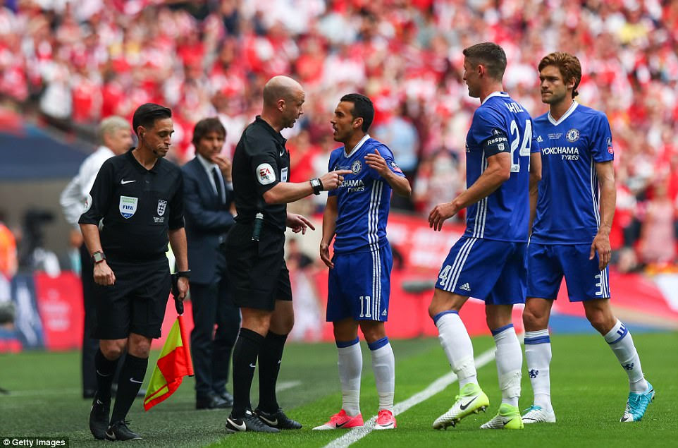 Chelsea's Pedro, Gary Cahill and Marcos Alonso question referee Anthony Taylor on his decision to award Sanchez's goal