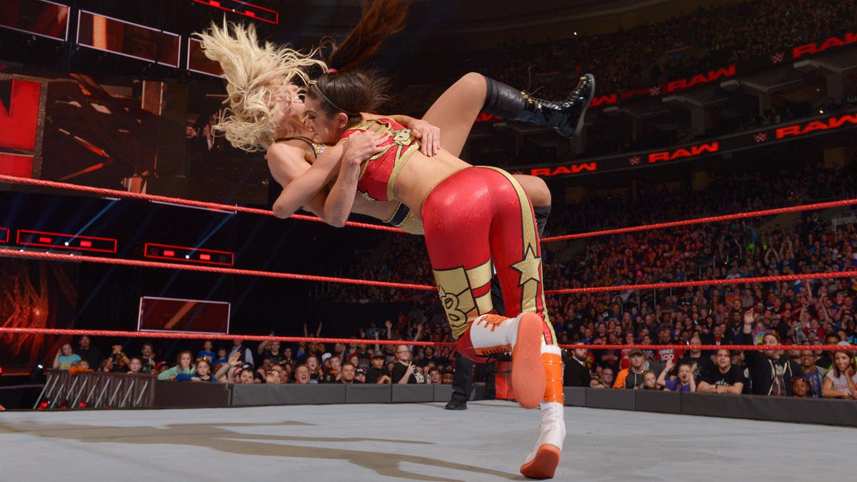 Bayley plants Charlotte with the Bayley-to-Belly Suplex.