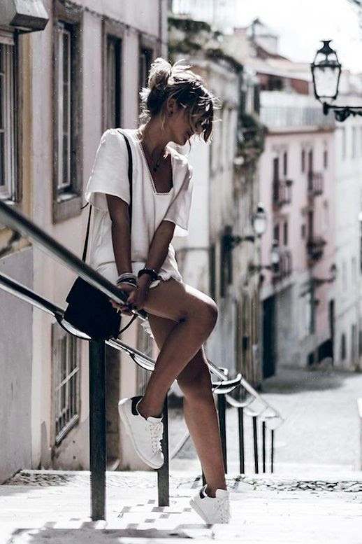 Le Fashion Blog Blogger Style Vacation Look Messy Bun Anine Bing White Dress With Tassels Bracelets Small Leather Bag White Sneakers Via @Mikutas