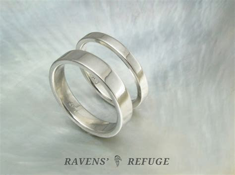 his and hers simple platinum wedding bands   Ravens' Refuge