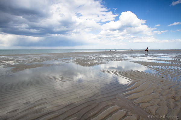 a beach made for walking as the water recedes