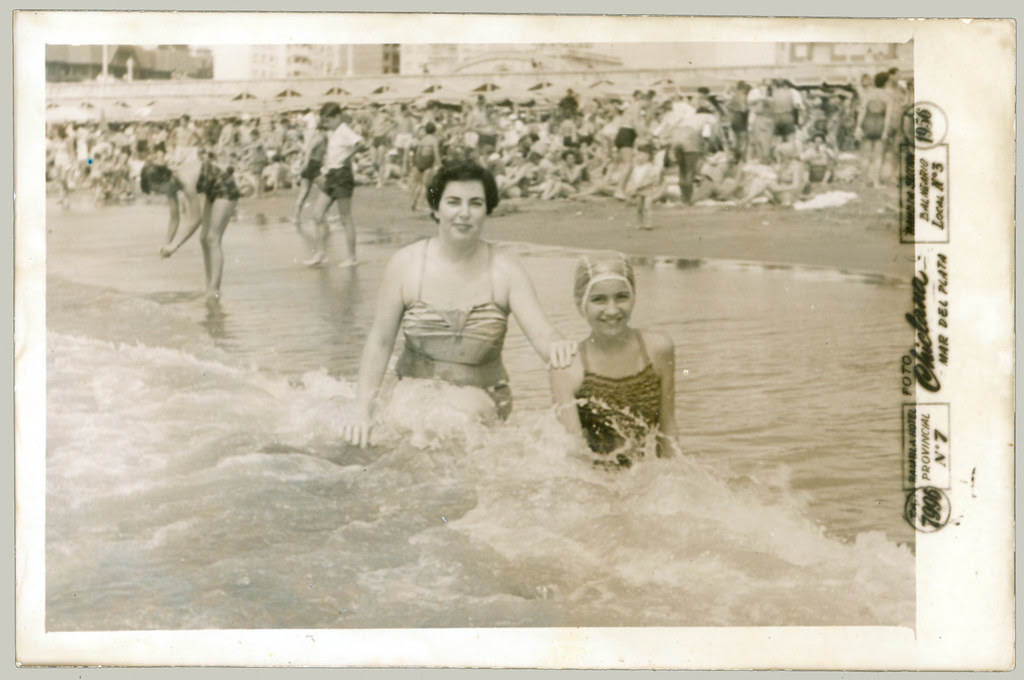 woman and girl in surf