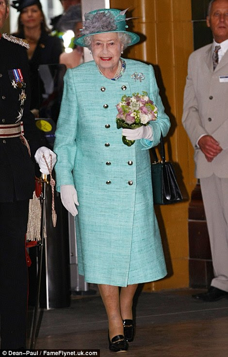 The Queen arrived at Nottingham Train Station where she was met by William, The Duke of Cambridge and Kate, The Duchess of Cambridge.