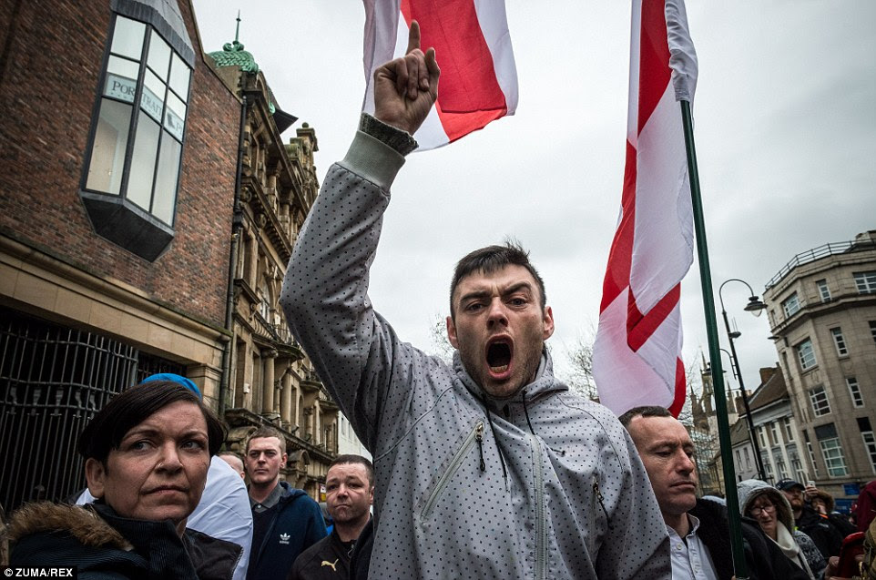 A man shouts as the rally makes it way past Bigg Market in Newcastle, as the protest's leader said Muslims would 'take over' Britain