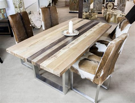 esstisch aus massivholz mit edelstahl der tischonkel