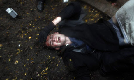 Brandon Watts lies injured as Occupy Wall Street protesters clash with police in Zuccotti Park