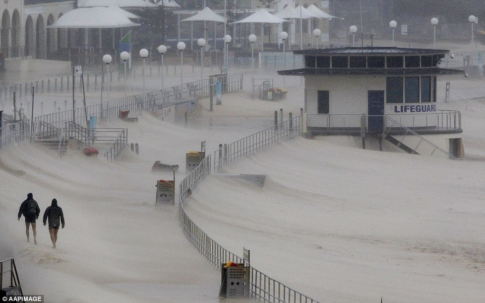 Sydney's famous Bondi Beach was almost deserted, as wild winds blew tons of sand off the beach and onto the promenade, covering it completely