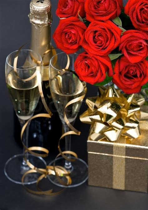Red roses and champagne on black     Stock Photo   Colourbox