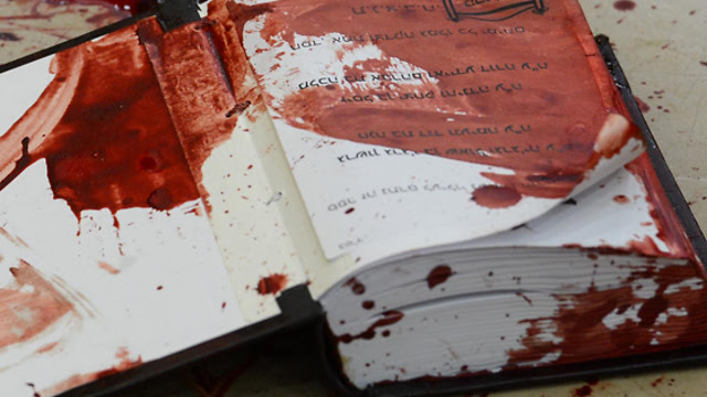 A bloodstained prayer book at the synagogue (Photo: GPO)