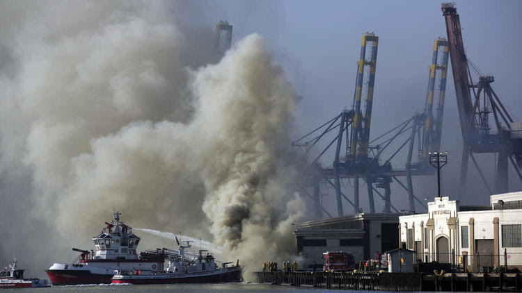 Fire crews work to contain Port of L.A. blaze