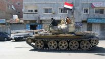 A pro-government tank on the streets of Taiz