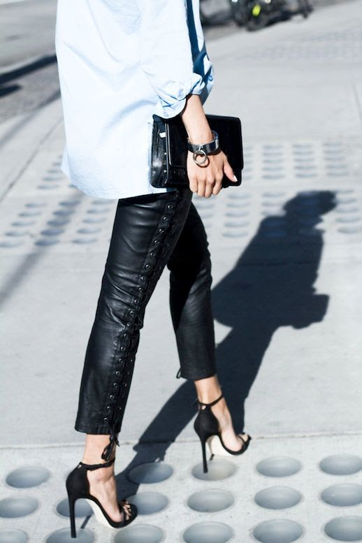 Le Fashion Blog Blogger Style Front Row Shop Blue Button Down Shirt Black Clutch Lace Up Leather Pants Stuart Weitzman Ankle Strap Heels Via The Haute Pursuit