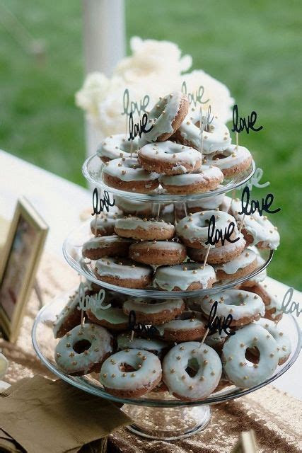 Picture Of a clear glass stand with lots of glazed donuts