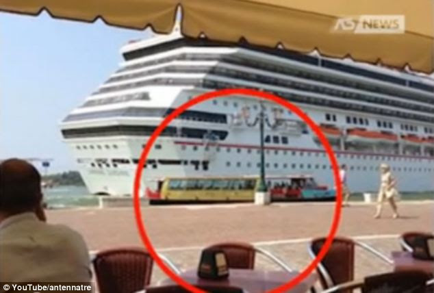 People in Venice have reacted with fury to footage showing a cruise ship which appears to pass within yards of the city's fragile shoreline